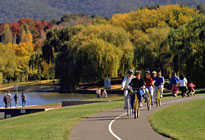 People riding around a lake in the ACT