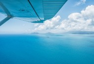 Neal Pritchard: A view across the Great Barrier Reef, Queensland, from under an airplane's wing